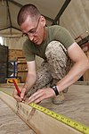 U.S. Marine Corps Cpl. Kenneth R. Storvick, a tool room noncommissioned officer in charge with Marine Support Squadron 271, measures wood at Camp Leatherneck in Helmand province, Afghanistan, April 1, 2013 130401-M-BU728-001.jpg