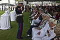 U.S. Marine Corps Staff Sgt. Stephen Cameron, left, assigned to Marine Aviation Logistics Squadron (MALS) 24, salutes Paul Goodyear, a Pearl Harbor survivor, during a ceremony marking the 71st anniversary of 121207-F-MQ656-339.jpg