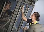 U.S. Navy Aviation Boatswain's Mate (Handling) 3rd Class Kelsey Schrempp cleans the windows of primary flight control aboard the aircraft carrier USS Nimitz (CVN 68) June 18, 2013, in the Gulf of Oman 130618-N-KE148-181.jpg