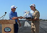 U.S. Navy Capt. Christopher Bolt, right, the commanding officer of the aircraft carrier USS Ronald Reagan (CVN 76), receives a gift from San Diego Chargers owner Alex Spanos during a morale-boosting event with 130828-N-SS432-009.jpg
