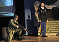 U.S. Soldiers perform an reenactment of Audie Murphy military biography, on stage, during an induction ceremony, at Sergeant Audie Murphy Club, in Fort Gordon, Ga. 091202-A-NF756-004.jpg
