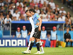 Cavani helped off the pitch in victory, 2018 (Image: Анна Нэсси)