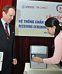 USAID Mission Director Francis Donovan learns how the equipment functions (6828698021).jpg