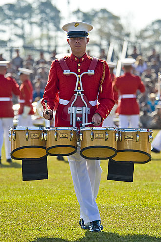 Drumline - A tenor player with four drums