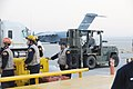 US Air Force 100113-F-5735S-536 Airmen load C-17s for Haitian relief.jpg
