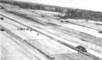 US Army engineer troops placing T-17 membrane on soil surface of an airfield runway in South Vietnam.png