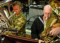 US Navy 030908-N-7712H-002 Royal Australian Army Band Musician Erskine Kelly , left, and Musician 2nd Class Roger Starcher, assigned to the U.S. Pacific Fleet Band, play their tubas.jpg