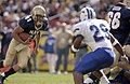 US Navy 031004-N-9818S-369 Navy quarterback Craig Candeto tries to out manuever Air Force defender Larry Duncan.jpg