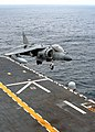 """US Navy 040317-N-2651J-002 An AV-8B Harrier jump jet assigned to the """"Bulldogs"""" of Marine Attack Squadron Two Two Three (VMA-223) makes it's final approach to the amphibious assault ship USS Saipan (LHA 2).jpg"""