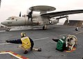 US Navy 040708-N-8213G-089 Aviation Boatswain's Mate Equipment 3rd Class Anthony Jackson assists Catapult Safety Officer Lt. Russ Dicks, in launching an E-2C Hawkeye off the flight deck aboard USS Ronald Reagan (CVN 76).jpg