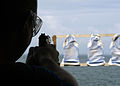 US Navy 050610-N-8053S-044 Photographer's Mate 1st Class James E. Perkins takes aim at his target during a live-fire 9mm small arms qualifications aboard the amphibious assault ship USS Wasp (LHD 1).jpg