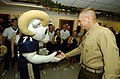 US Navy 051130-N-9693M-006 The Commandant of the Marine Corps Gen. Michael Hagee gives the U.S. Naval Academy mascot, Bill the Goat his challenge coin after he performed one-arm pushups.jpg