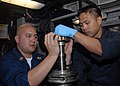 US Navy 060208-N-4973A-139 Two Sailors assigned to USS John C. Stennis (CVN 74), Machinist's Mate 1st Class Michael Buncab, right, and Machinist's Mate 1st Class Jason Mamac, rebuild the number four chill water pump aboar.jpg