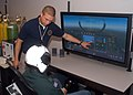 US Navy 070626-N-6247M-008 Hospital Corpsman 2nd Class Brandon McMahan, from Indianapolis, shows a Boy Scout the aircraft simulator used with reduced oxygen breathing device (ROBD).jpg
