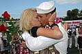 US Navy 070820-N-7138C-142 A Sailor assigned to Arleigh Burke-class guided-missile destroyer USS O'Kane (DDG 77) kisses his wife after returning from a seven-month deployment.jpg