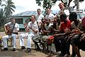 US Navy 070908-N-3255B-008 U.S. Navy Europe-Africa Band musicians sing a popular African song with children at Yatima Group Orphanage.jpg