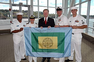 Flags of cities of the United States - Image: US Navy 070914 N 6362C 001 Roy Buol, mayor of the city of Dubuque, presents Sailors assigned to amphibious transport dock USS Dubuque (LPD 8) with a flag of the city