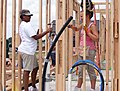 US Navy 080607-N-7902T-053 Personnel Specialist 3rd Class Lindsey Nabbefeld helps Demetrice Johnson, a Hurricane Katrina victim, work on her Habitat for Humanity home during Oklahoma City Navy Week.jpg