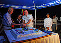 US Navy 080724-N-9689V-007 The Honorable Hans G. Klemm, Maria Paixao, and Capt. William A. Kearns III cut a cake during a farewell reception.jpg
