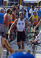 US Navy 081011-N-0995C-004 Lt. Cmdr. Damon Dixon enters the bicycle phase of the 30th Ford Ironman World Championship.jpg