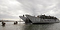US Navy 081207-M-5633L-001 Marines assigned to Bravo Company, 1st Battalion, 13th Marine Expeditionary Unit exit a landing craft utility during a noncombatant evacuation operation scenario.jpg