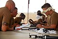 US Navy 090313-N-7367K-012 Seabees assigned to Naval Mobile Construction Battalion (NMCB) 1 are blind-folded while breaking down then reassembling M-16 service rifles.jpg