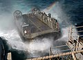 US Navy 090324-N-4236E-102 A landing craft air cushion (LCAC) from Assault Craft Unit (ACU) 4 returns to the multi-purpose amphibious assault ship USS Iwo Jima (LHD 7) after disembarking Marines and equipment.jpg