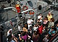 US Navy 090524-N-4936C-118 Lt. Cmdr. McCormack Harkin, commanding officer of the Cyclone-class coastal patrol ship USS Tempest (PC 2), explains the elements of his ship to civilians during a ship's tour on Staten Island.jpg