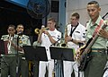 US Navy 090626-N-1722M-061 Musician 2nd Class Collin Reichow, center left, and Musician 2nd Class John Wylie, both assigned to the U.S. 7th Fleet Rock Band Orient Express, perform with the Malaysian Armed Forces KOMBO D' Tiger.jpg