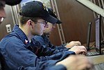 US Navy 100419-N-8913A-047 Sailors assigned to the aircraft carrier USS George H.W. Bush (CVN 77) check their e-mail in the ship's library.jpg