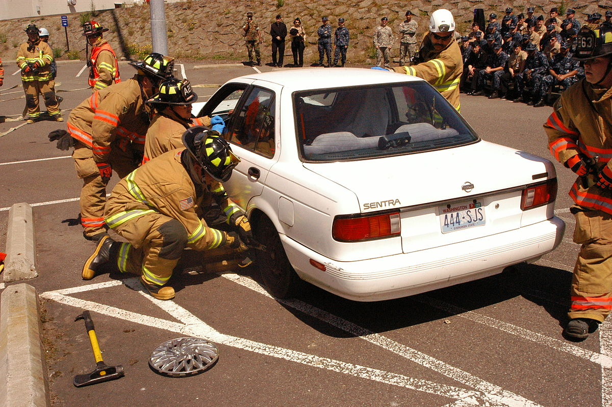 US Navy 100623-N-4386D-002 Fire fighters from Naval Base Kitsap tend to injured passengers during a simulated car crash rescue operation as part of a.jpg