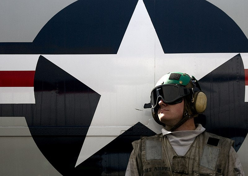 File:US Navy 110331-N-6320L-042 Aviation Structural Mechanic 2nd Class Jason Arpei waits to unload cargo from a C-2A Greyhound aboard USS Carl Vinson (C.jpg