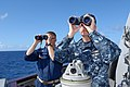 US Navy 110422-N-ZI300-040 Cmdr. Christopher Nerad, executive officer of the guided-missile destroyer USS Nitze (DDG 94), and Capt. Marc Weeks, com.jpg