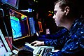 US Navy 110611-N-UO379-185 Operations Specialist 2nd Class Stephen Sittner, from Denver, identifies and tracks air contacts in the Combat Direction.jpg