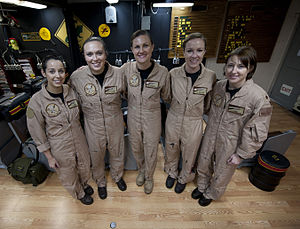 US Navy 120125-N-DR144-012 Members pose for a photo before flying the first all-female-crewed combat mission in an E-2C Hawkeye, aboard the Nimitz.jpg