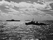 Black and white photo of three warships at sea