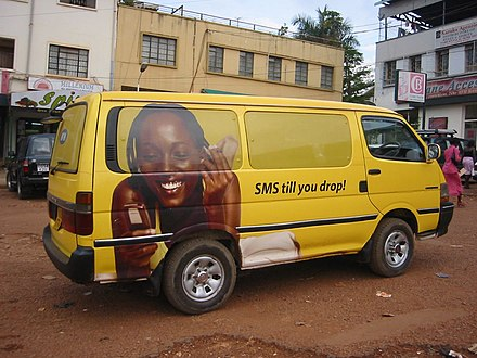 An advertisement for a mobile phone carrier on a van in Kampala. Uganda - ad on van in Kampala.jpg