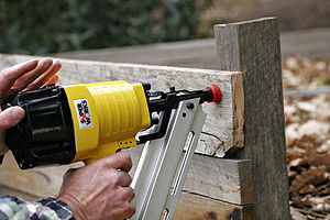 Nail gun - Pneumatic nail gun in use