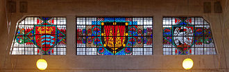 Middlesex - Coats of arms of Middlesex (left) and Buckinghamshire (right) in stained glass at the exit from Uxbridge tube station.