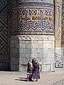 Uzbek Women Walk Past Ulugbek Medressa - The Registan - Samarkand - Uzbekistan (7488520590).jpg