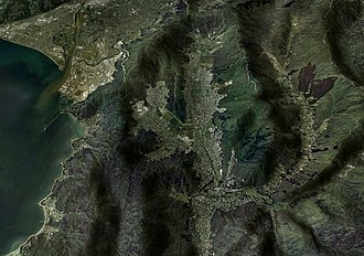 Wainuiomata - An aerial view of the Wainuiomata Valley. The Hutt Valley and Wellington Harbour appear on the left, with Moores Valley to the right.