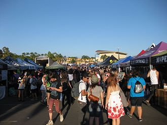 Warped Tour - Artist, record label, and sponsor tents occupy the central area of the tour stops, selling merchandise and holding autograph signings.