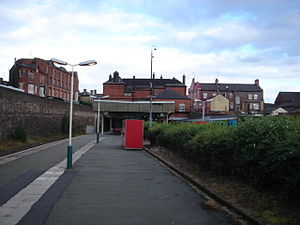 Wigan Wallgate railway station - View along the platform in the Manchester direction, with the rear of the main station building visible on the road overbridge.