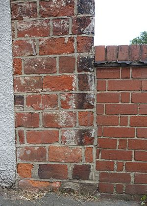 Brick tax - Wilkes Gobs oversize bricks in the wall of former Ashby Canal warehouse alongside modern bricks of bridge parapet, High Street, Measham.