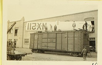 Boxcar - A Santa Fe door-and-a-half boxcar being loaded with the wing from the Spirit of St. Louis