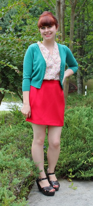 Miniskirt - A woman wearing a red miniskirt