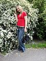 Woman in red tea-shirt and blue jeans in Poland-17May2008.jpg