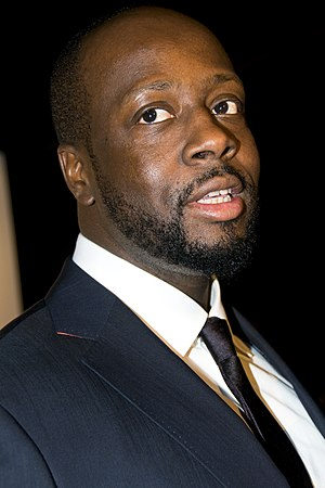 "She Wolf - Having previously collaborated with Shakira on ""Hips Don't Lie"", Wyclef Jean (pictured) was featured on the song ""Spy"" in She Wolf."