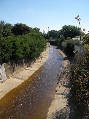 Yarrowee River - View of the Yarrowee River between Black Hill and East Ballarat west toward Peel Street.  The Ballarat railway station clock tower is visible in the distance