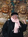 Yonah L. Marks in front of two Buddhas in Beijing, China.jpg